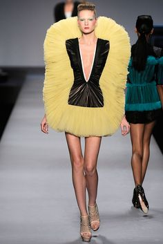 Viktor & Rolf- spring 2010 ready to wear: conch inspired because big ruffles go around her head