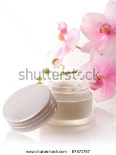 pot of moisturizing face cream and beautiful orchid flowers - stock photo