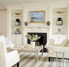 Paired with built-in storage units, this white fireplace becomes a natural anchor point for the living room's furniture arrangement, thanks to its substantial expanse. White sofas and chairs arranged…More Fireplace Bookshelves, Fireplace Built Ins, White Fireplace, Fireplace Surrounds, Fireplace Design, Fireplace Wall, Fireplace Ideas, Farmhouse Fireplace, Bookcases
