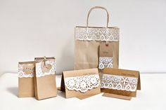 Beautiful and cheap favour boxes/bags  Wedding or Party Favour (Favor)  Bags -  Kraft Paper Gift Bags. £10.00, via Etsy.