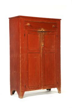 American 1st Half 19th Century Red Painted, pine and poplar jelly cupboard having one drawer over two double paneled doors on cutout feet.  Garths Auction