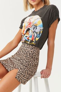 A woven mini skirt featuring an allover leopard print, high-rise waist, concealed back zipper, and a side vented hem. Printed Skirt Outfit, Leopard Skirt Outfit, Leopard Print Outfits, Leopard Print Shorts, Printed Skirts, Skirt Outfits, Leopard Print Top, Animal Print Skirt, Estilo Boho