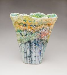 Ceramic artist Heesoo Lee brings the textural depth of aspen forest canopies to her sculptural bowls and vases. Lee painstakingly places each and every leaf by hand, building unique, organic trees that seem to come to life with their shimmering, colorful leaves. While the vibrant glazes add a lifeli