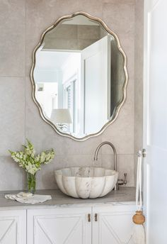 Oval scalloped mirror with fluted marble bain in travertine power room bathroom in coastal white home. King Single Bed, Beacon Lighting, Level Homes, Antique Paint, French Oak, Sunshine Coast, White Houses, Beautiful Bathrooms, Glass Table