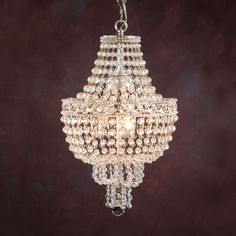 Three-light chandelier with crystal beads. Details on our website: DecorativeCrafts.com #decorativecrafts #decorative #lighting #lightfixture #chandelier #interiordesign #interiordecor #interior #lightfixtures #chandeliers #ceiling #homedesign #roomdesign #officedesign #elegant #chic #lavish #luxury #luxurious #crystal