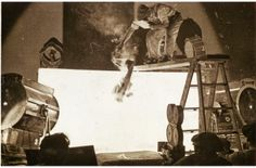 Gus White drops the flaming bi-plane past a blue screen for subsequent matting into the scene.