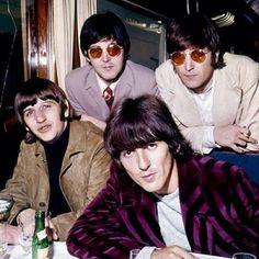 Bottom left~Ringo Starr/Drummer & Vocals.Bottom right~George Harrison/Lead Guitarist & Vocals.Upper left~Paul McCartney/Rhythm Guitarist & Lead Vocals.Upper right~John Lennon/Guitar,Piano & Lead Vocals.
