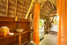 House in Puerto Jiménez, Costa Rica. Beautifully designed open air home just steps from the beach.  Casa Troya reflects the typical home design of the Osa Peninsula with its half-height walls and natural, local building materials. It has a fully equipped kitchen and bathroom downstai...