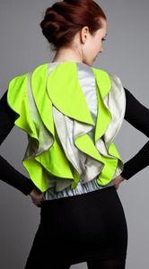 Reflective safety vest with cascading ruffles from Vespertine.