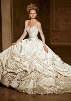 I love this dress because of how full the skirt is. I love the ruffles and the lace as well:Eve of Milady - Bridal Gowns