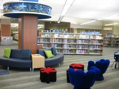 Youth Spaces: The Discovery Zone at Strathcona County Library is designed for school-age children. A puzzle motif runs throughout the section, while story rings circle columns within the space. A separate TeenZone offers funky furniture and a homework help section, and a Reading Tree marks the library's early-literacy area. http://hfksarchitects.com