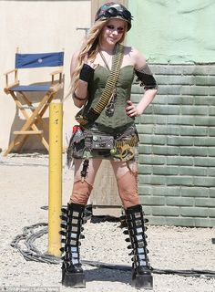 Tough girl: Avril Lavigne buried herself in layers of bullets and grenades to dress as Tank Girl on Thursday for her latest music video
