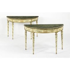 A pair of Italian Neoclassical style green and polychrome-painted demi-lune console tables | lot | Sotheby's