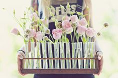 flowers in test tubes! Science inspired wedding flower center piece. Test tube wedding flower displays. Incorporate a little personality into your wedding, analytical, science? - test tube flowers :)