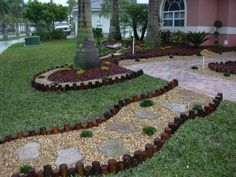 Beautiful Images Of Garden Yard Landscaping Design And Decoration Ideas : Astonishing Image Of Garden Yard Landscaping Decoration Using Wooden Slab Garden Edging Including Light Grey Stone Slab Garden Path And Light Pink Exterior Wall Paint  Color Scheme