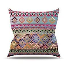 Kess InHouse Nika Martinez - outdoor accent pillows  Give your backyard , patio or porch life again by using some cool and unique outdoor throw pillows.  Bold and bright shades of green, red, blue, orange and yellow are crazy popular and currently trending.  It is easy to change the look of your outdoor seating area by simply changing your pillows.  It does not matter if your home is Tuscan, cabin or shabby-chic, you will find the best decorative outdoor throw pillows.