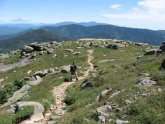 A hiker explores Mount Lafayette, the highest point on Franconia Ridge.