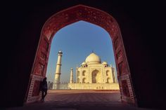 An Enduring Tribute -- The gleaming white marble of the Taj Mahal's main mausoleum is framed by a red sandstone archway of the complex's mosque and assembly hall. Arches feature prominently in Islamic architecture. The Taj Mahal was built in the 1600s in Agra, India, as a tribute by emperor Shah Jahan to his favorite wife, who died in childbirth. -- Photo by Crescent Media -- National Geographic, Photo of the Day, Best of September 2016 -- saved 10-17-16