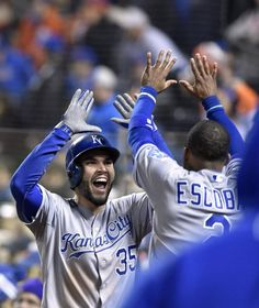 Kansas City Royals first baseman Eric Hosmer celebrates with shortstop Alcides Escobar after Hosmer scored in the eighth inning off a single by catcher Salvador Perez during game four of the World Series on Saturday, October 31, 2015 at Citi Field in New York.