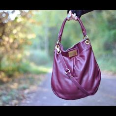 Marc Jacobs Classic Q Hillier Hobo in plum I decided I need to get rid of this if I want to buy more! This is in used condition with some scratches on the hardware/leather and some coloring/fading in areas. The inside fabric is slightly faded/colored as well. Although this is still in perfectly usable condition! Very cute!!! See photos :) Marc Jacobs Bags Hobos