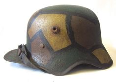 WW1 M18 'Cut Out' Helmet with M18 Liner and camouflage paint. http://www.warhats.com/store/p552/WW1_M18_%27Cut_Out%27_Helmet_with_M18_Liner_and_camouflage_paint.html www.warhats.com