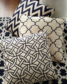 Different patterns of throw pillows in black and white