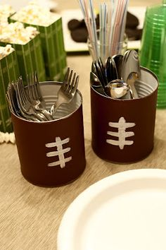 Football Silverware Caddies ~ paint tomato cans with acrylic paint. Painted right over the paper label which will look a bit like leather once it is dry.