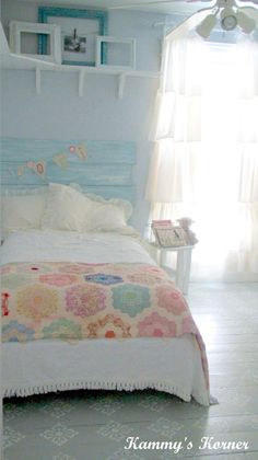 sweet little girls room...DIY headboard painted to patch a cute quilt...white everything else. This would also be easy to change out if you wanted to.