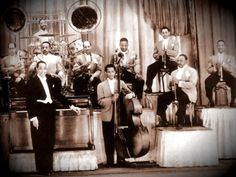 This style of music is commonly referenced as one of the largest Big Band Era influences as many ragtime bands used swing beats with brass instruments and ensemble arrangements (as seen in big bands). Description from fsuworldmusiconline.wikidot.com. I searched for this on bing.com/images