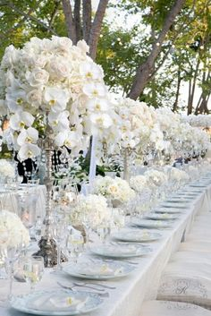all white tablescape with white flowers
