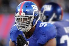 Justin Tuck adds six more bars to his facemask for NFC Championship New York Giants Football, Nfl Football Helmets, Sports Helmet, American Football League, National Football League, Justin Tuck, Nfl Uniforms, Helmet Logo, Football Conference