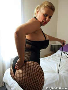 busty big booty British dominatrix in fishnets