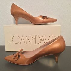 "🎉HP🎉 Joan & David Gardner Pumps 7.5 Gold Patent ""Wear on sole and heel. Comes in original box with dust bag."" Chic and fashionable, Joan & David's Gardner pumps feature pretty teardrop cutouts and a dainty bow over the instep, complete with a stylish pointed toe and kitten heel. Joan & David is an international trend-setting brand employing high-quality materials and excellent craftsmanship Shimmery patent leather Teardrop cutouts with bow Kitten heel Joan & David Shoes Heels"