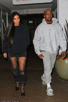 All good: Kim stayed close to her man as the couple continued to dispel any talk of marital problems