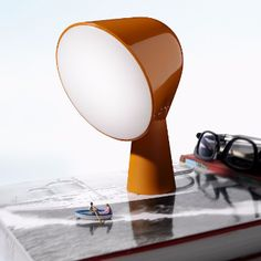The colorful and unusual shape of BINIC whets the imagination and is appealing. The round glossy finish of the shade is supported by a conical satin finish base, casting an intense and uniform spotlight downwards.