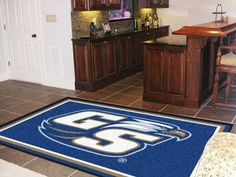 """Georgia Southern University Rug 5x8 - Show your team pride and add style to your tailgating party with Sports Licensing Solutions 5'x8' area rugs. Made in U.S.A. 100% nylon carpet and non-skid Duragon(R) latex backing. Officially licensed and chromojet printed in true team colors.FANMATS Series: RUG5X8Team Series: Georgia Southern UniversityProduct Dimensions: 59.5""""x88""""Shipping Dimensions: 31""""x20""""x6"""". Gifts > Licensed Gifts > Ncaa > All Colleges > Georgia Southern University. Weight: 15.80"""