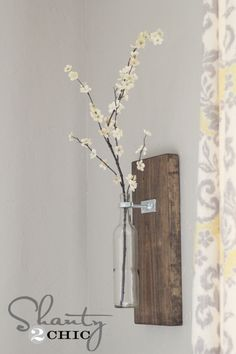 Turn an ordinary wine bottle into this amazing vase to hang on the wall