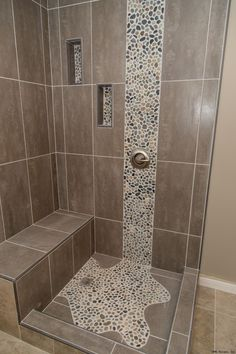 spruce up your shower by adding pebble tile accents click the pin to get started on your next bathroom remodeling project more