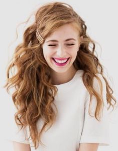gorgeous waves with lots of volume + a pretty hair clip