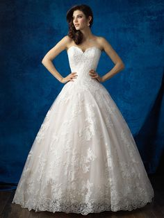 Allure Bridals 9353 Scalloped edging and layered tulle introduces a delicate play of textures into this strapless ballgown. Colors: White, Ivory, Champagne/