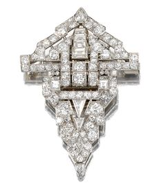 DIAMOND DOUBLE CLIP BROOCH, 1930S Designed as a stylised open work arrow-head, set with circular-, brilliant-, single- and step- cut diamonds and further embellished with variously-shaped stones, French import marks, cased.