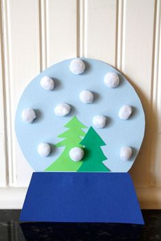 #Christmas Month: Toddler-approved Pom Pom Snow Globe    It was a great little morning craft activity, and Isaiah was super proud of it.  We started with cardstock paper in different colors: dark blue for the base, light blue for the globe, and two shades of green for the trees.     I penciled in the shapes and cut them out, while Isaiah practiced his cu