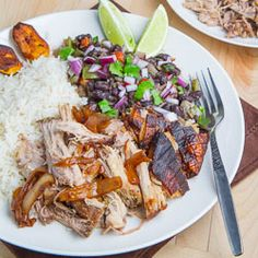 Cuban Roast Pork (Lechon Asado) with Caramelized Onions, Crackling, Rice, Cuban Style Black Beans and Fried Plantains