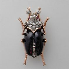 A LATE NINETEENTH CENTURY GARNET AND DIAMOND BEETLE BROOCH