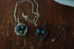 "Silver filled 16"" chain and wire wrapped bird nest with three ceramic ""robin eggs"" and adorned with a antiqued brass sparrow.  Lead and nickel free. $25"