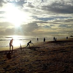 """Another day at """"our"""" beach in Meddawatta Sri Lanka. Kids playing cricket on the beach while the sun slowly sets on yet another evening stroll down to the Meddawatta Beach a short walk from our AirBnB house. The island then called Ceylon became a British colony in 1802 and where there are Brits there is cricket right? Now cricket is by far the most popular sport here!  Photo taken with an Olympus Stylus TG-4 during the GuideVenturous Asian Tour in December 2015.  #srilanka #matara #meddawatta…"""