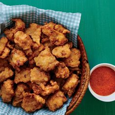 Lionfish Fritters with Red Bell Pepper Coulis - Sustainable Seafood Chef Barton Seaver's Best Recipes - Coastal Living Chickpea Fritters, Cauliflower Fritters, Potato Fritters, Seafood Recipes, Appetizer Recipes, Salad Recipes, Appetizers, Seafood Dishes, Alcapurrias Recipe