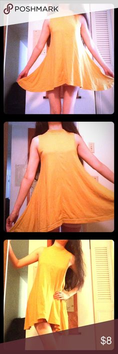 """Mustard Yellow Dress-like Top This sporty top bellows out at the bottom almost like a dress. Bust is about 34"""" and it's 28"""" long. Great for the summer and the beach. Used condition, from a pet- and smoke-free home. Bundle to save. Thanks for looking! Tops"""