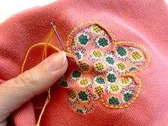 Using reverse appliqué to mend holes.