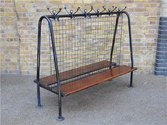 Vintage school cloakroom stand with numbered hooks and bench seats. This has the look of the moment.